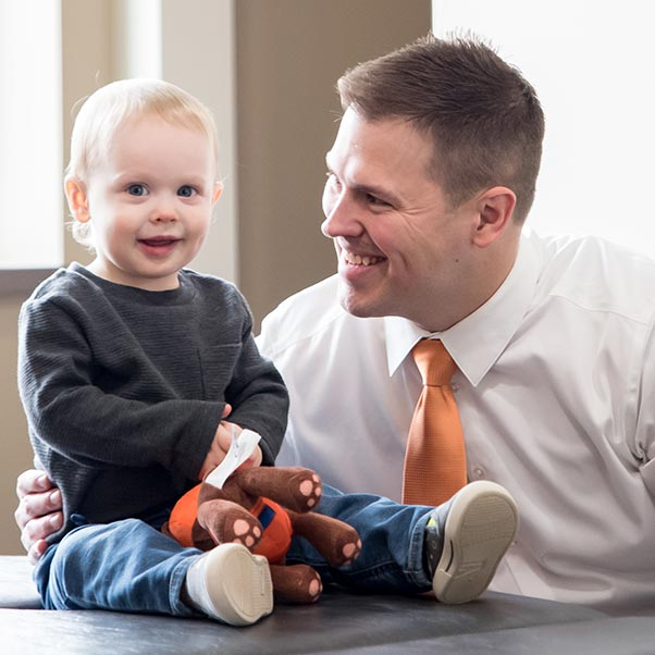 Chiropractor Maplewood MN Nicholas Okins With Baby