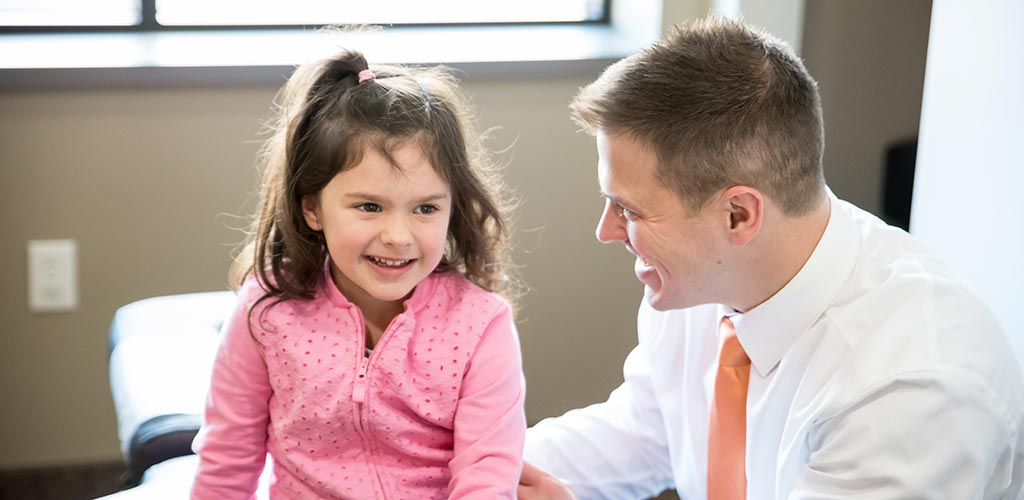 Chiropractor Nicholas Okins with Happy Child