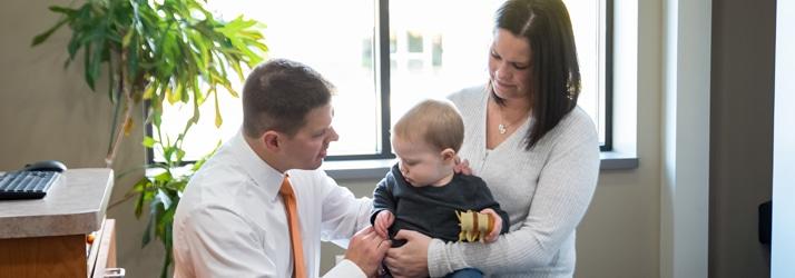 Chiropractor Maplewood MN Nicholas Okins Adjusting Child